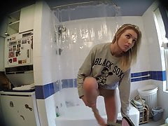 Cute Skinny Blonde Dressing in Bathroom on Spy Cam